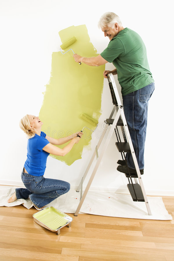 Man and woman painting wall. royalty free stock photography