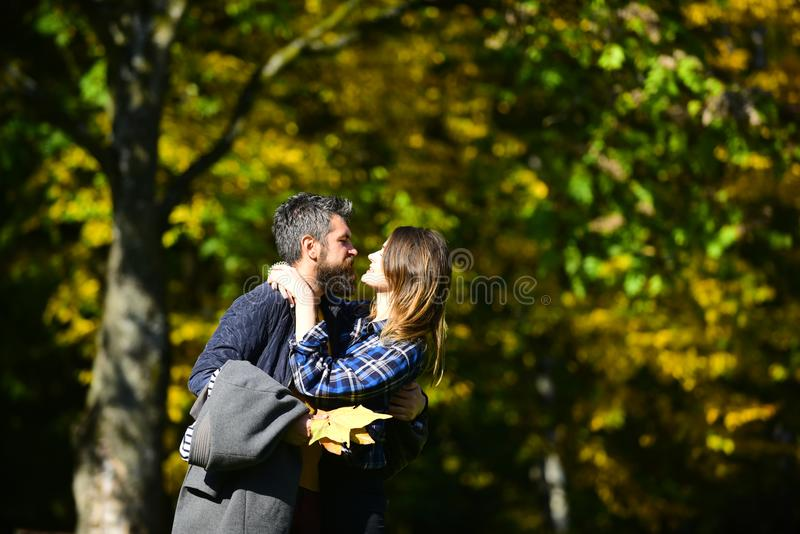 Man and woman with passionate faces on natural background. stock photography