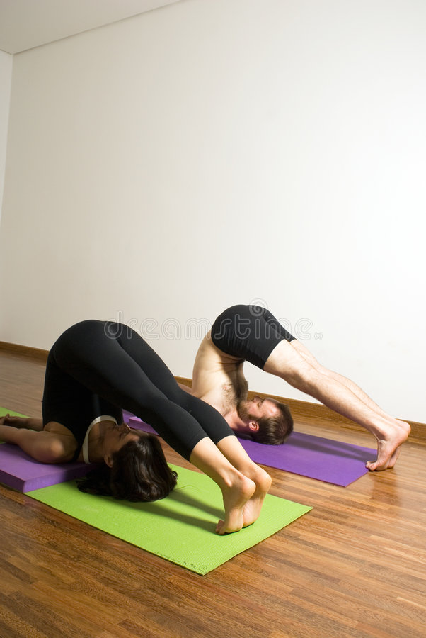 Download Man And Woman Performing Yoga Exercise - Vertical Stock Photo - Image: 5616100
