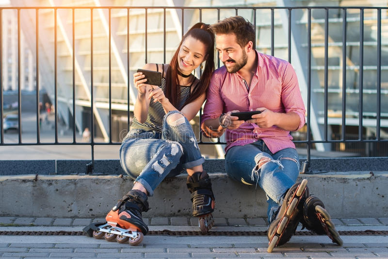 Man and woman with phones. stock photo