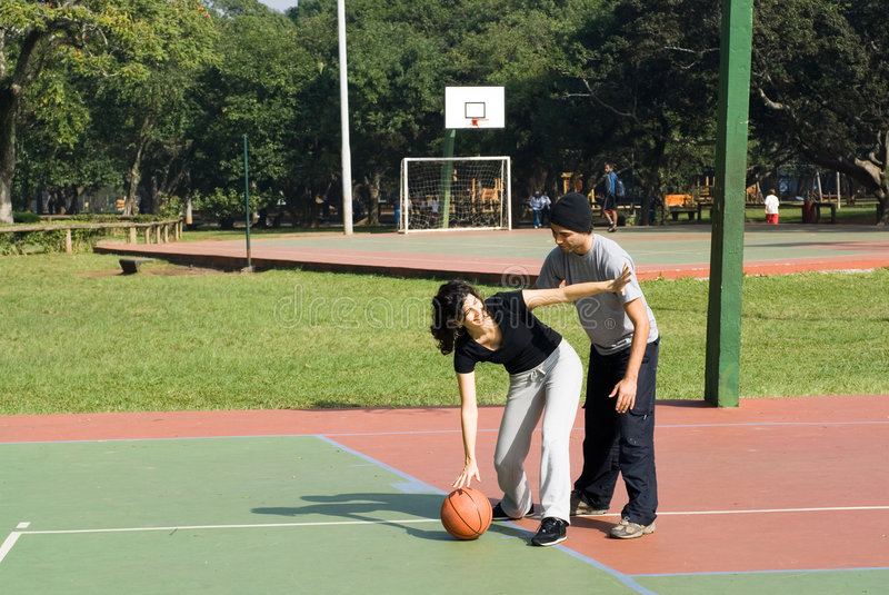 A Woman Playing Basketball Imágenes De Stock A Woman: Man And Woman Playing Basketball