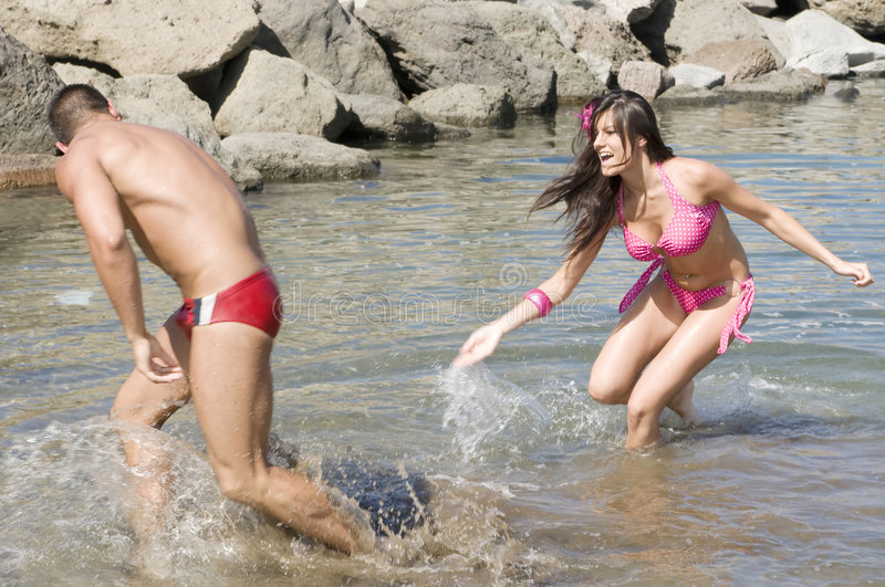 Download Man And Woman Playing With The Water Stock Photo - Image: 6522172