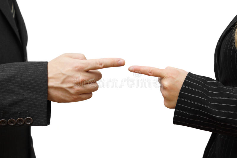 Man and woman pointing against each other. Business conflict royalty free stock photos
