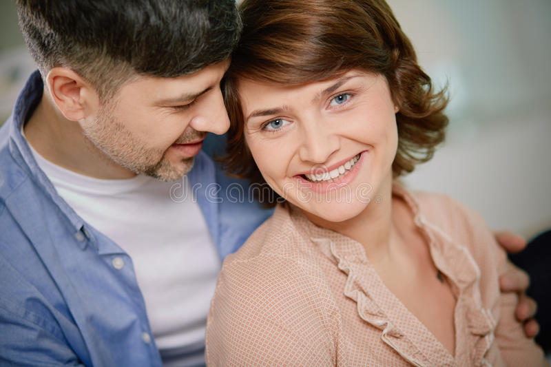 Man and woman. Portrait of middle aged women looking at camera with her husband near by royalty free stock images