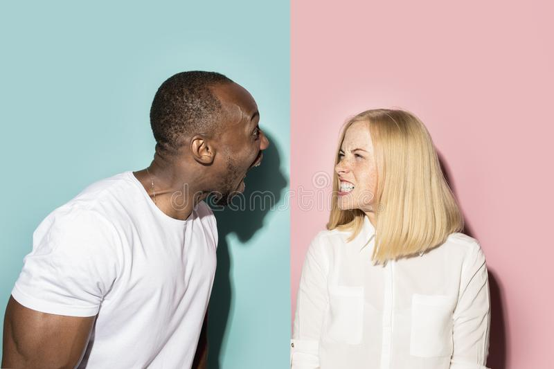 Man and woman posing at studio during quarrel stock image