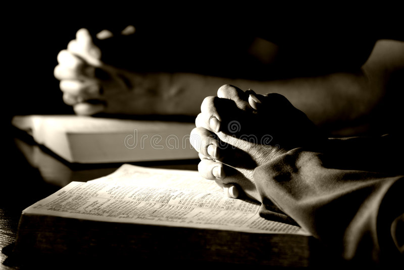 Man & Woman Praying Bibles (BW) royalty free stock photography