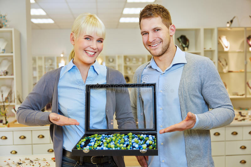 Man and woman presenting jewelry royalty free stock image