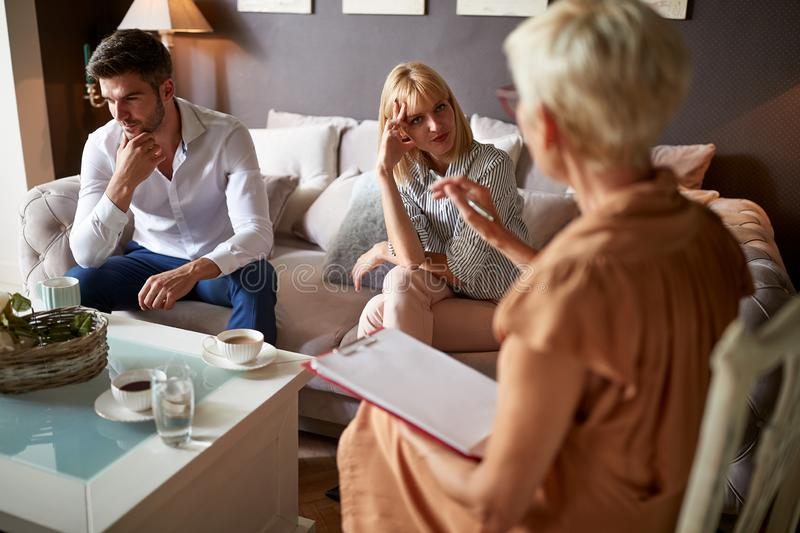 Man and woman in psychological counseling stock images