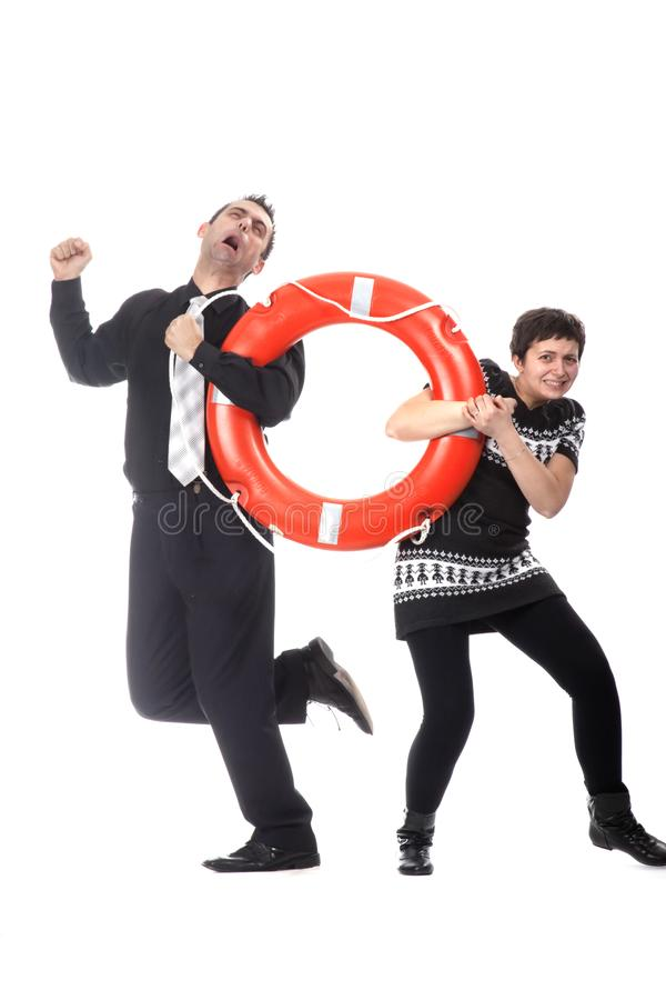 Man and woman pulling lifebuoy royalty free stock photo
