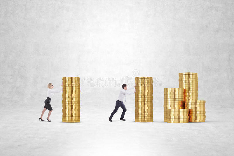Man and woman pushing giant stacks of coins stock photography