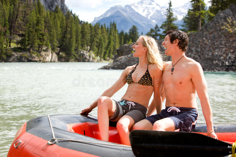 Man and Woman Rafting. A man and woman rafting on a river royalty free stock image
