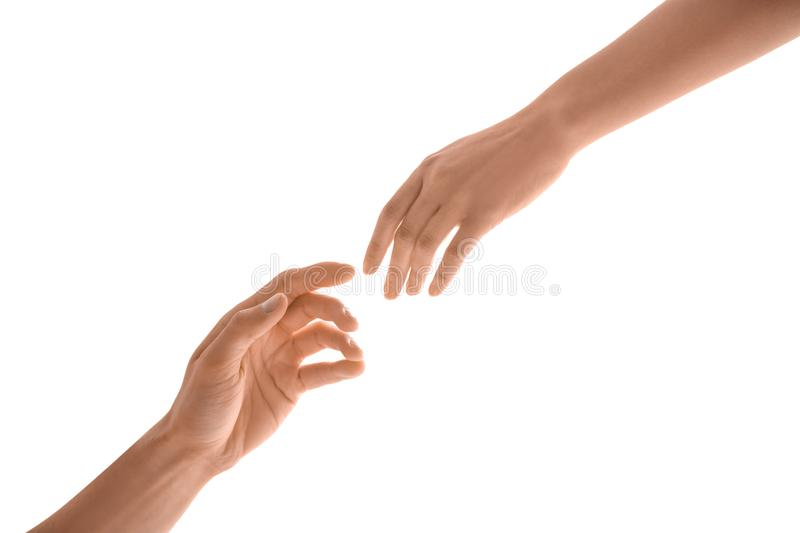 Man and woman reaching out to one another stock images