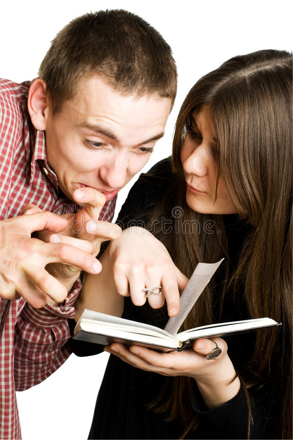 Man and woman reading a book royalty free stock photography