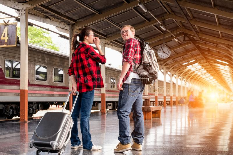 Man and Woman in Red Flannel Shirts at the Subway stock photo