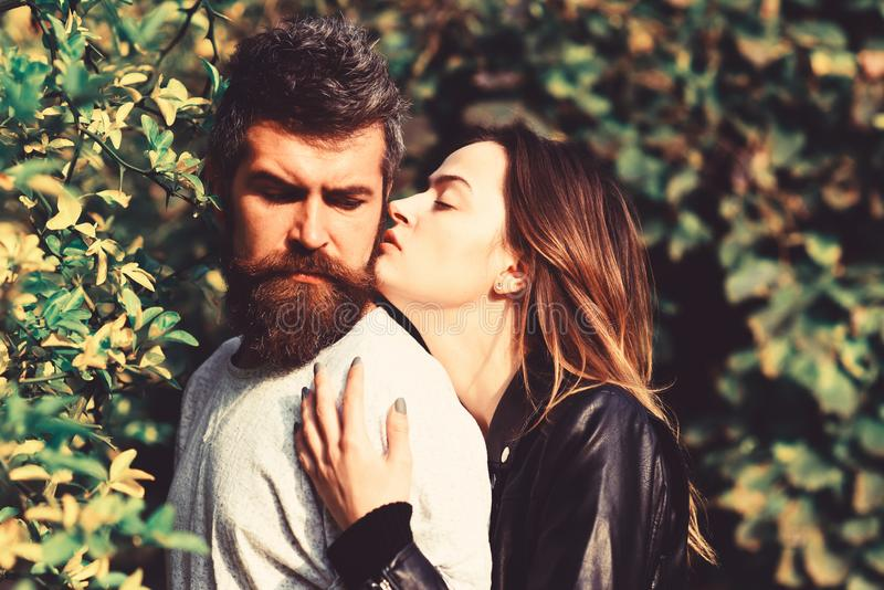 Man and woman with romantic faces on autumn trees background. royalty free stock photo
