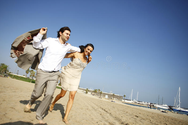 Download Man And Woman Running On Beach Stock Photo - Image of laughing, honey: 23615948
