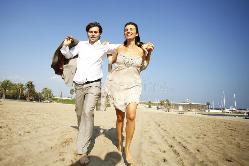 Download Man And Woman Running On Beach Stock Photo - Image of outside, honeymoon: 23615994