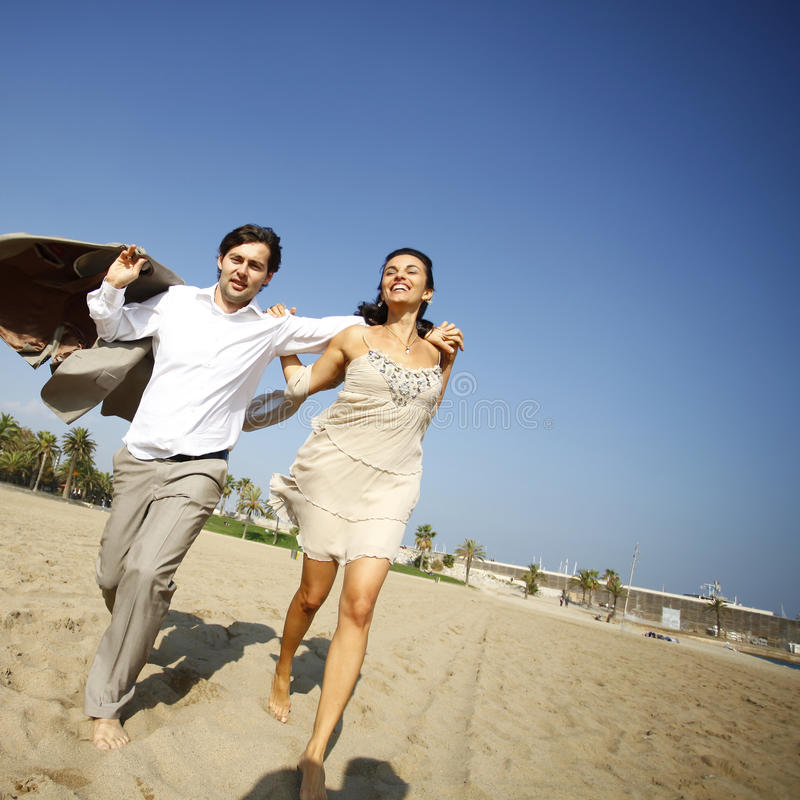 Download Man And Woman Running On Beach Stock Image - Image: 23616043