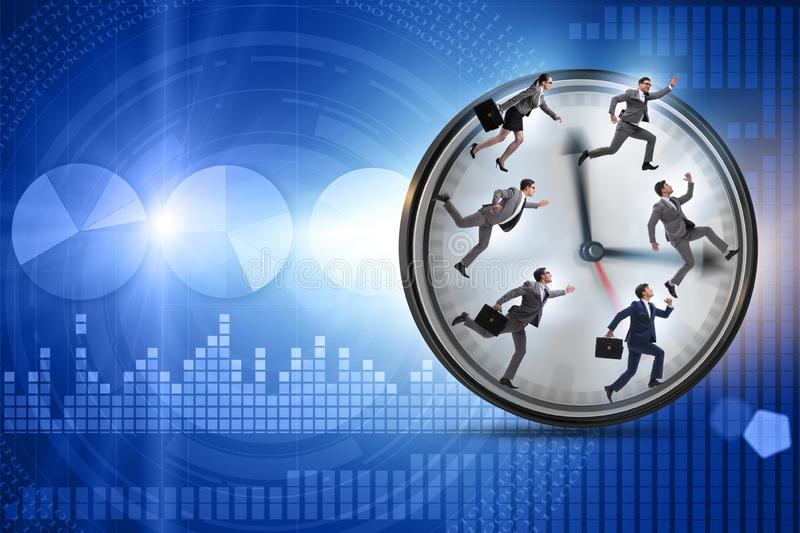 Man and woman running on clock royalty free stock photo