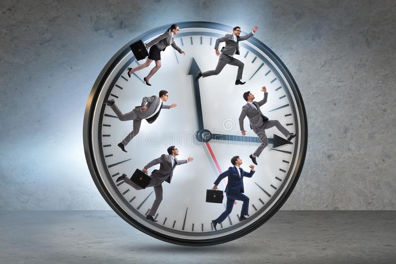 Man and woman running on clock. The men and women running on clock stock photo