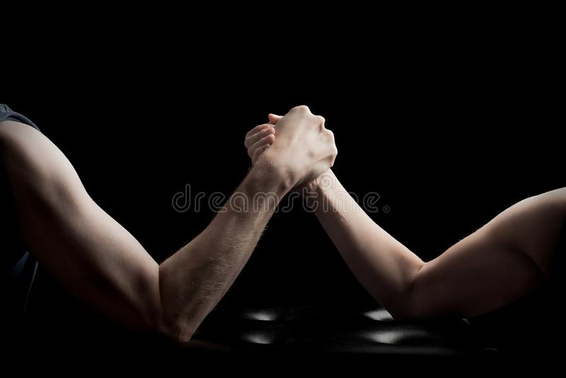 Arm wreslting man woman black background stock photo