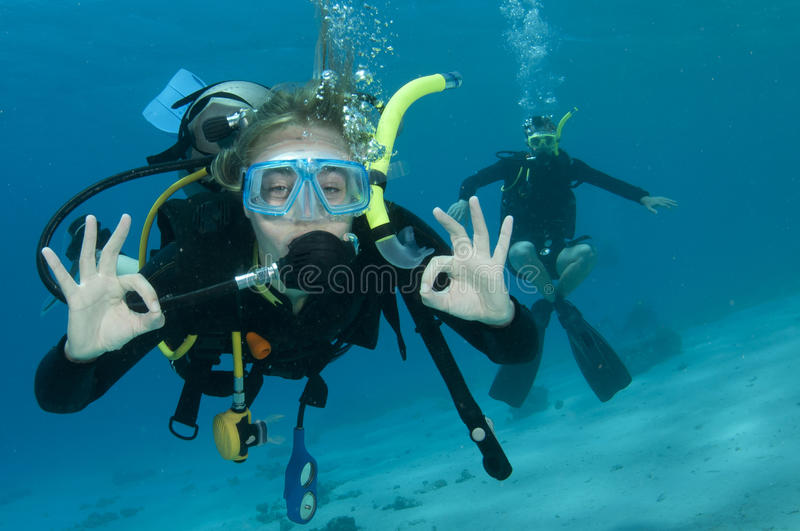 Man and woman scuba dive togeather stock images