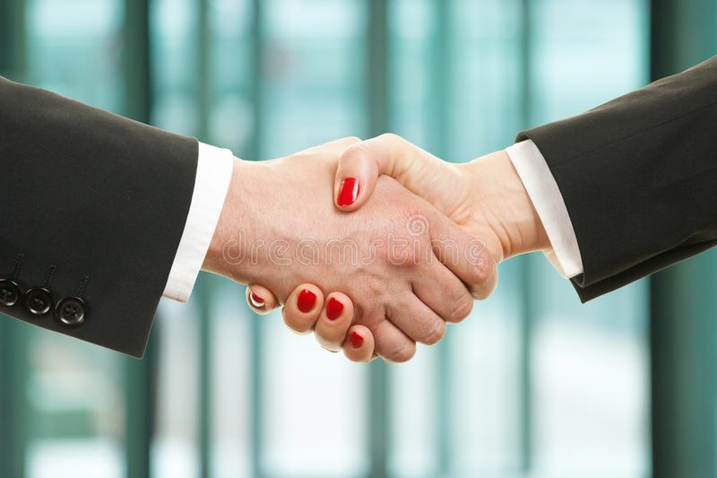 Man and woman shake hands stock image