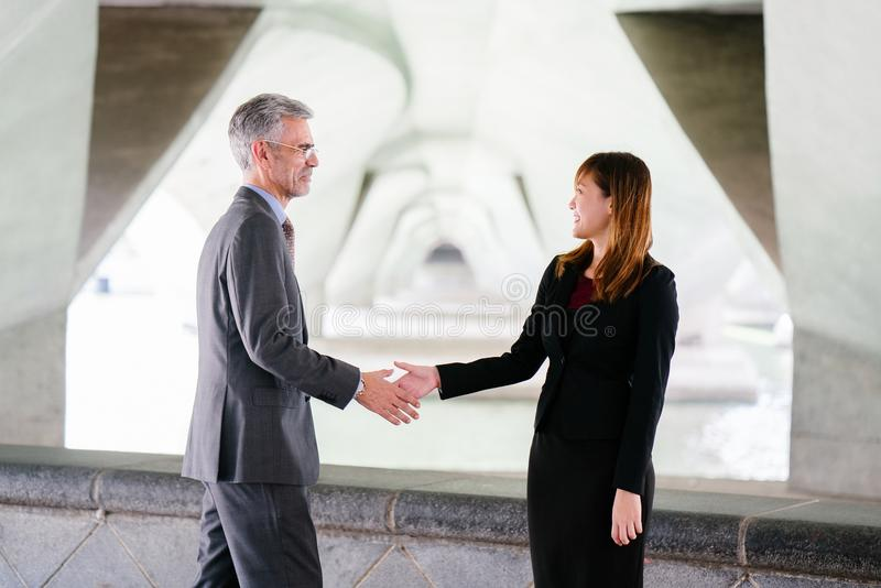 Man and Woman Shaking Hand in Focus Photography stock image