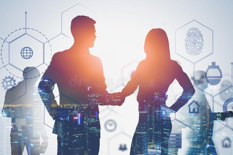 Man and woman shaking hands, hi tech interface stock photography