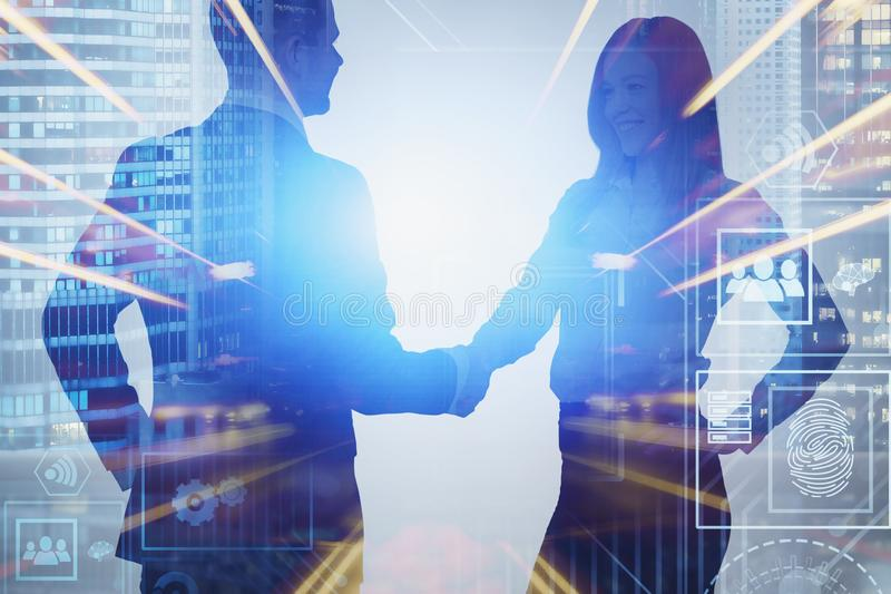 Business partnership and digital interface. Man and woman shaking hands in night city with double exposure of business interface. Concept of partnership and hi stock images