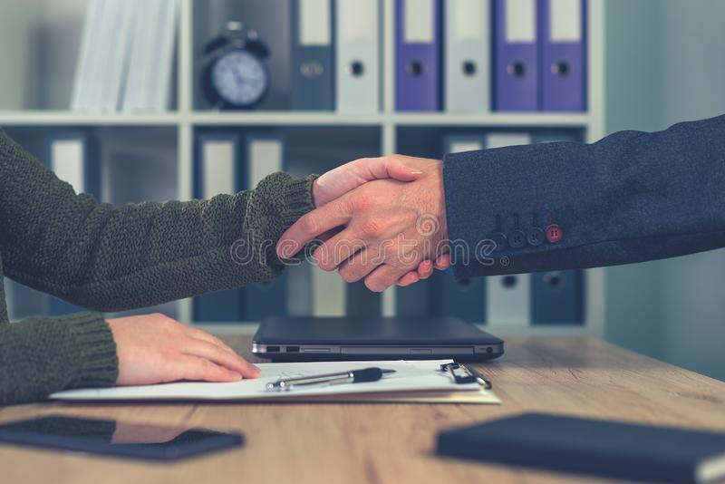 Man and woman shaking hands over business agreement. Man and woman shake hands over business agreement. Start up business female entrepreneur making handshake stock images