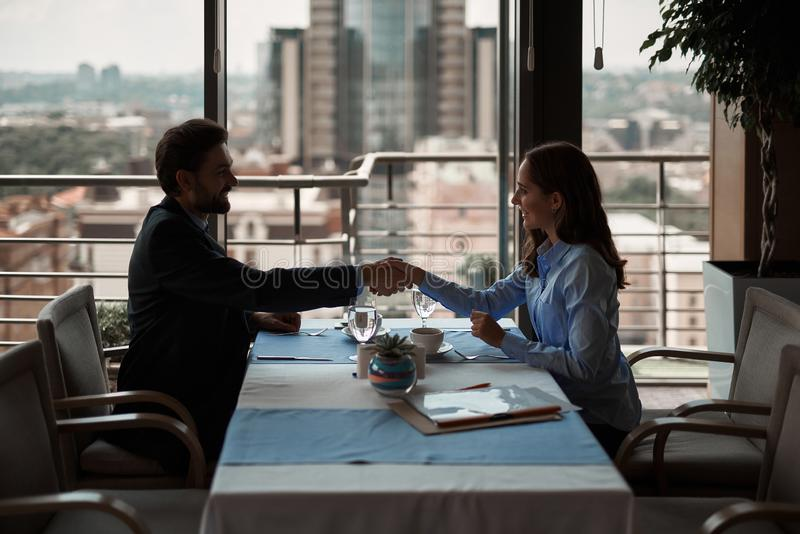 Man and woman shaking hands to have business deal royalty free stock photos