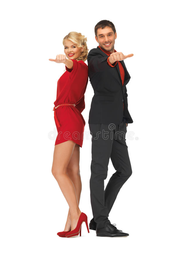 Man and woman showing thumbs up, down stock photos