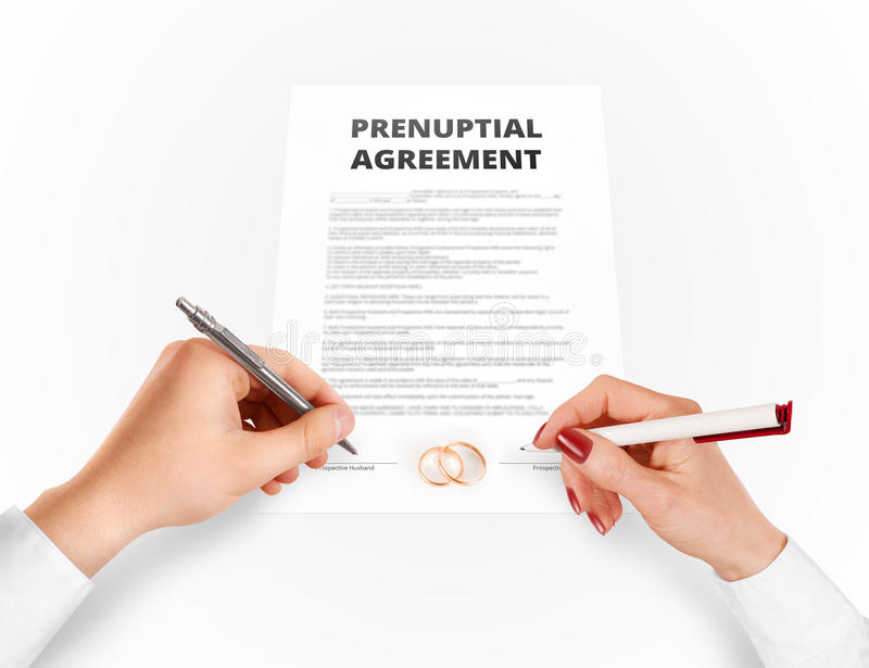 Man and woman sign prenuptial agreement near gold rings. Legal prenup document contract signing by newlywed couple. Marry partners signature on prenupt stock image