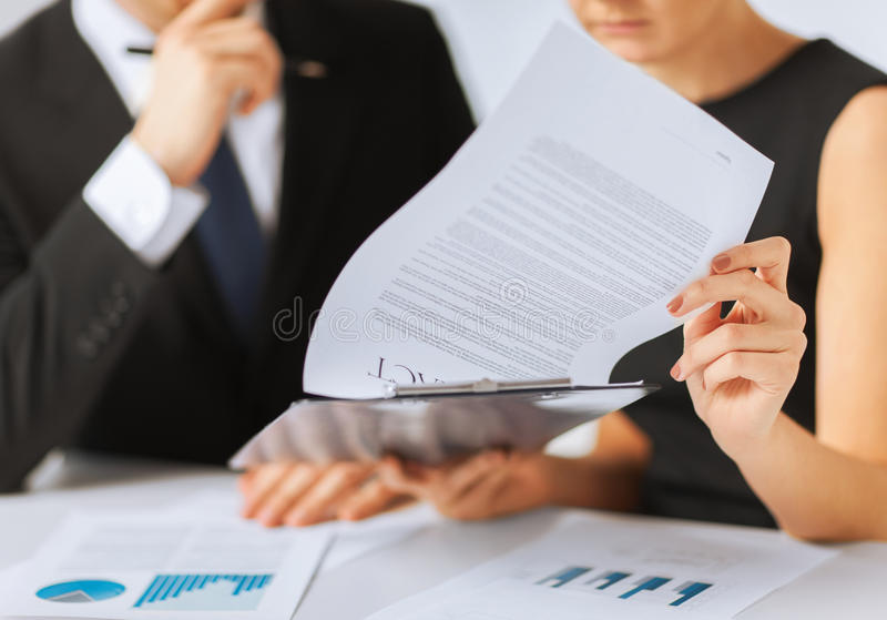 Man and woman signing contract paper stock image