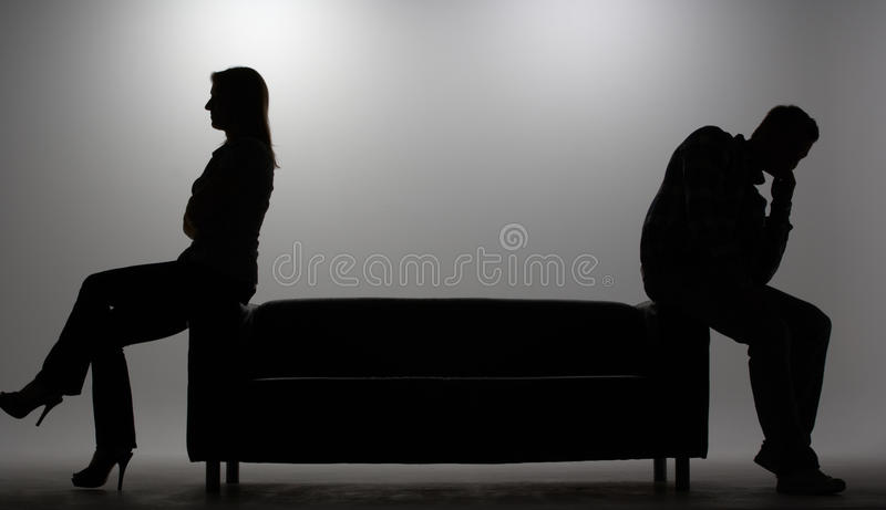 Man and woman in silhouette royalty free stock photography