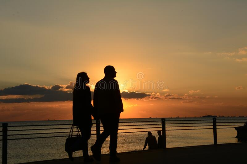 Man and Woman Silhouette Walking during Sunset royalty free stock images