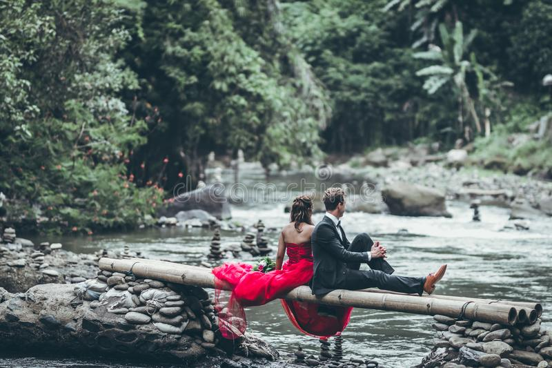 Man And Woman Sitting On Bamboos royalty free stock image
