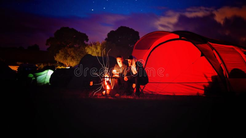 Man and Woman Sitting Beside Bonfire during Nigh Time stock images