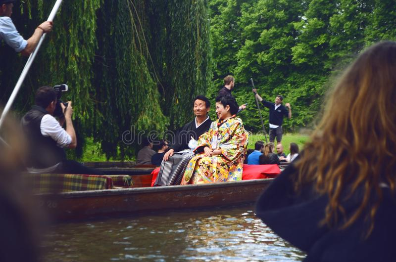 Man and Woman Sitting on Brown Canoe royalty free stock images