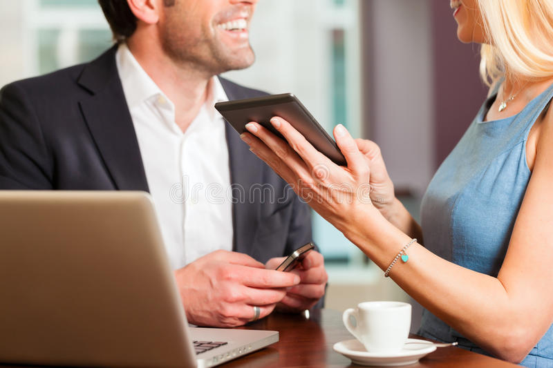 Download A Man And A Woman - Sitting In Cafe Stock Image - Image: 26622331