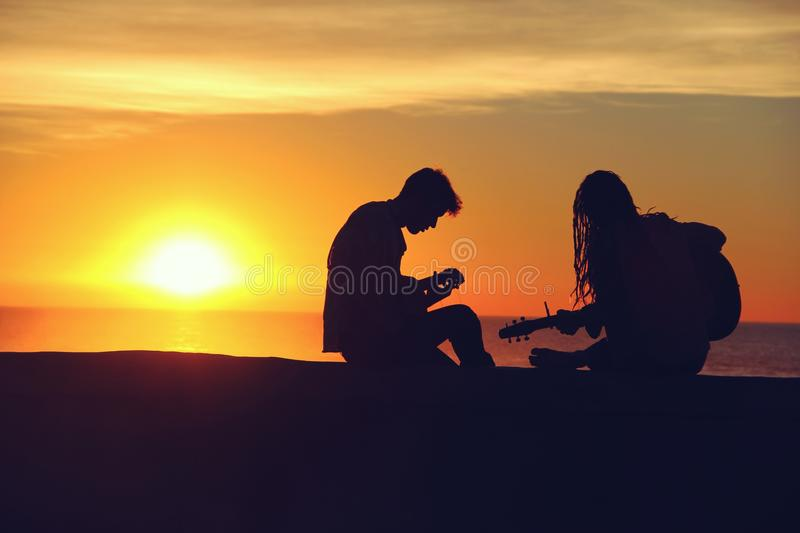 Man And Woman Sitting And Playing Guitar Free Public Domain Cc0 Image