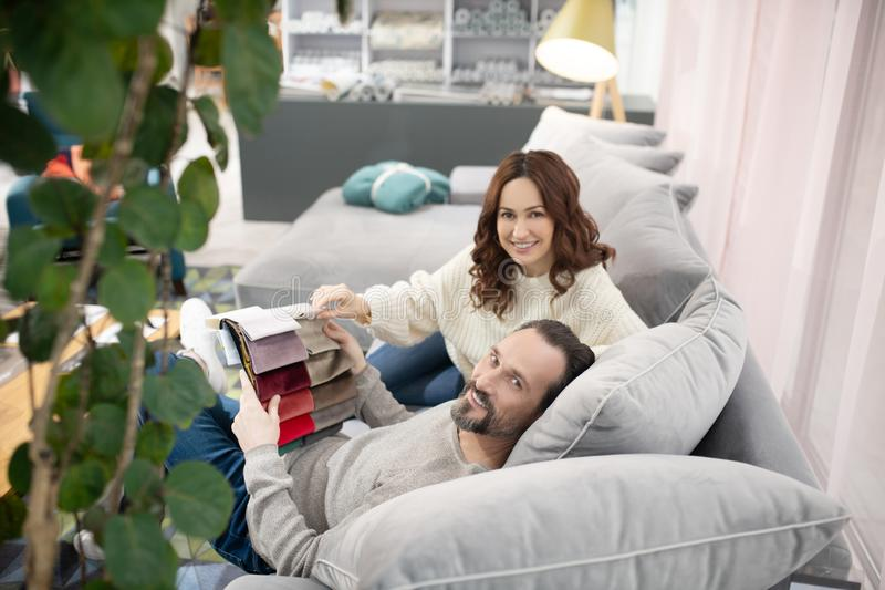 Man and woman sitting on the sofa feeling relaxed royalty free stock photo