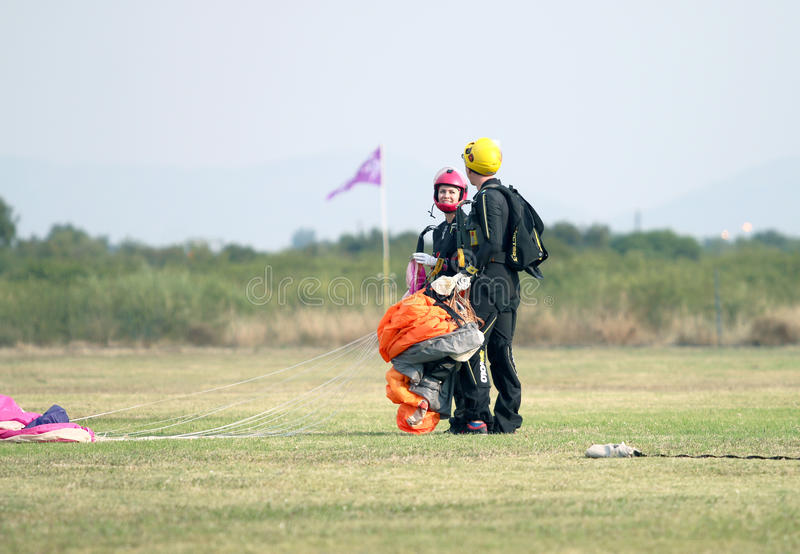 Man and woman skydiving and lover partners talking after success stock images