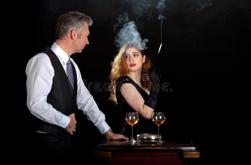 Man woman smoke wine bar royalty free stock images