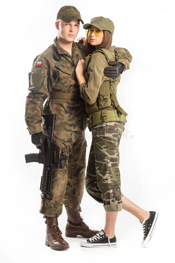 Man and woman in soldier`s suit on white background. royalty free stock photo