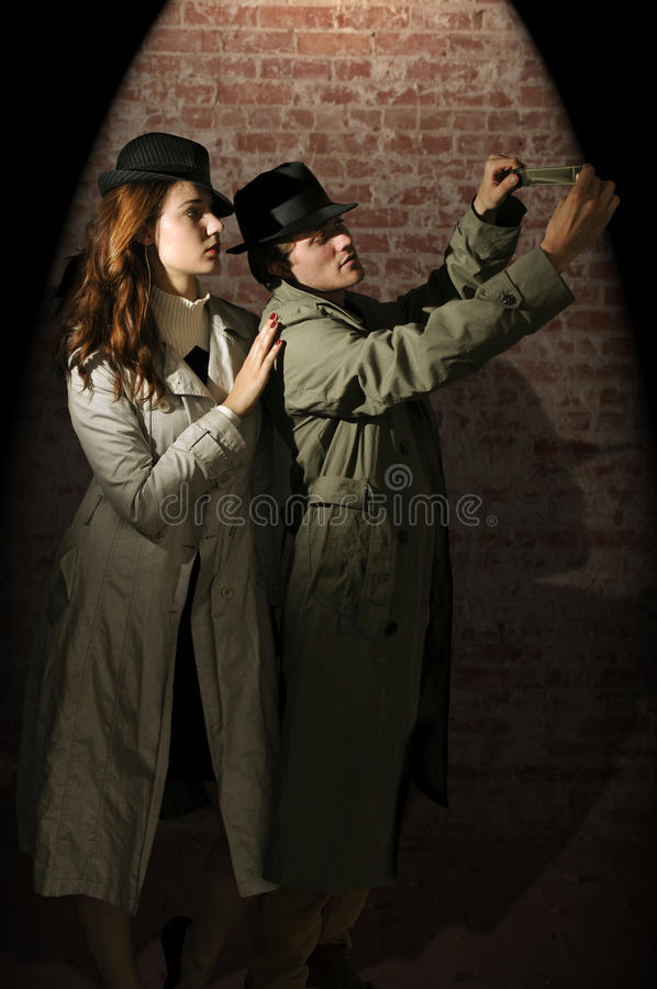 Man and woman spies stock photography