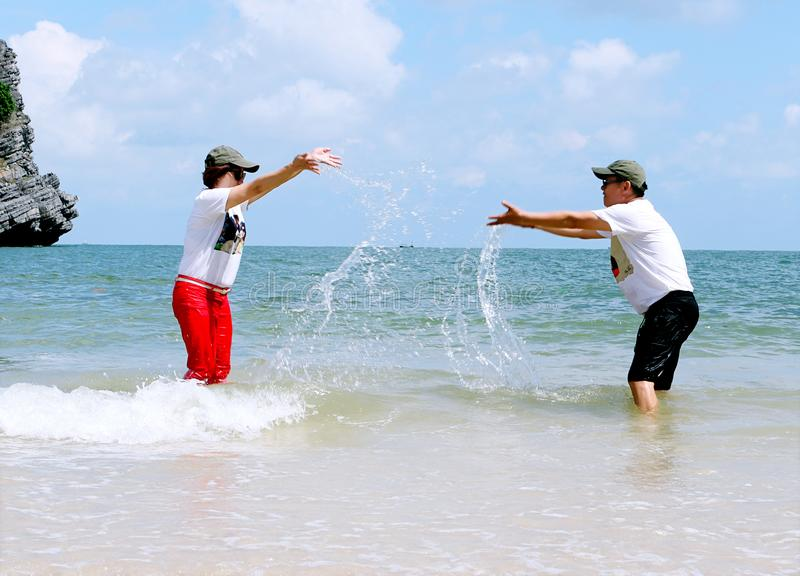 Man And Woman Splashing Water To Each Other royalty free stock photo