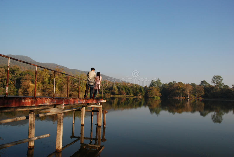 Man and woman stand on bridge royalty free stock photo
