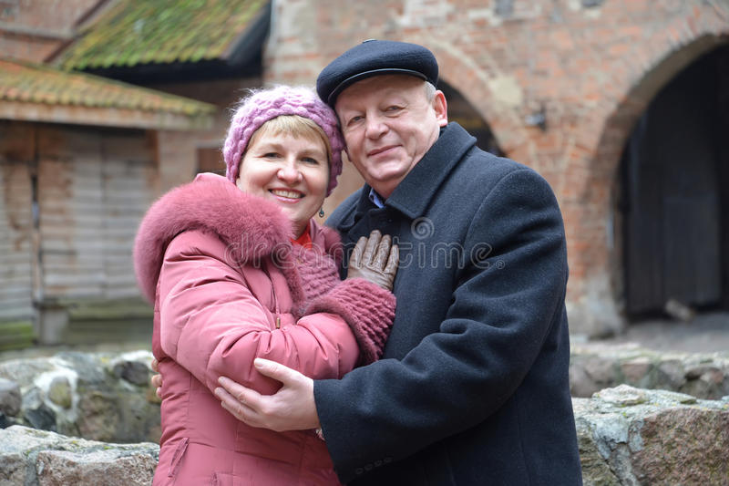 The man and the woman stand having embraced in the territory of the lock of the Teutonic Order. The men and the women stand having embraced in the territory of stock images